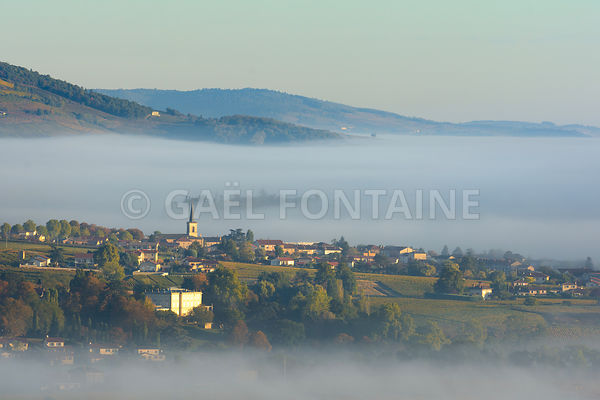 Village of Saint Etienne des Oullieres in Beaujolais land during sunrise