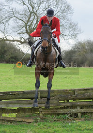Peter Collins jumping a hunt jump at Ingarsby