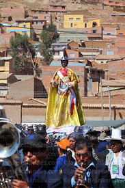 Brass band accompanies San Bartolome during procession at start of Chutillos festival, Potosí, Bolivia