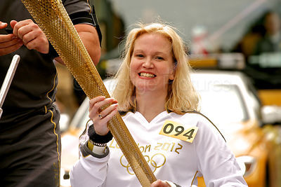 Julie Darwin Holding the 2012 Olympic Torch