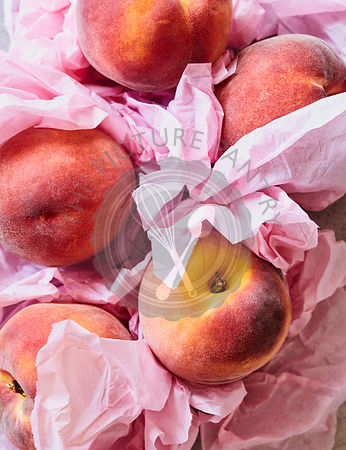 Fresh Peaches in Pink Tissue
