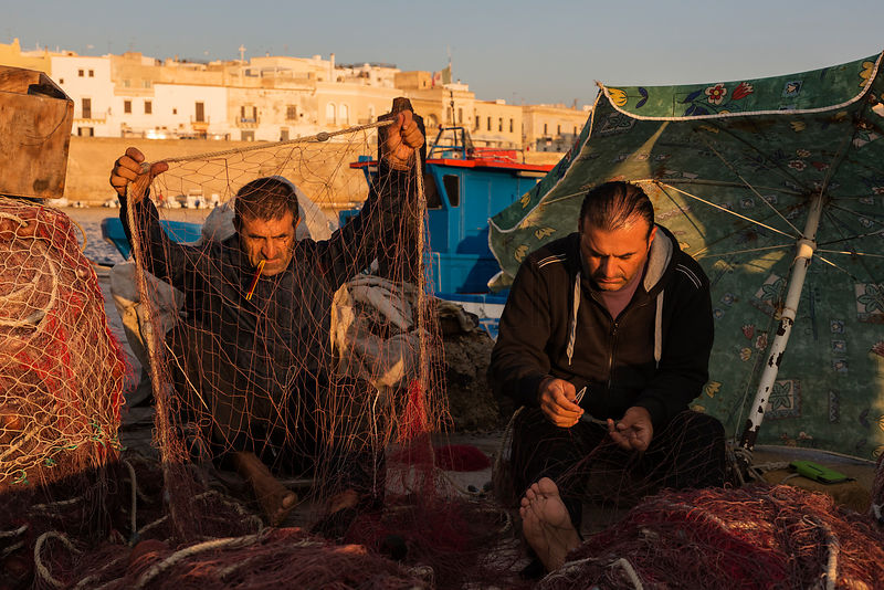 Fishermen Adriano and Walter Repairing their Nets in the Harbour of the Old Town