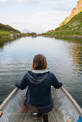 Austria, Tyrol, Fieberbrunn, Wildseeloder, woman in a boat on lake Wildsee