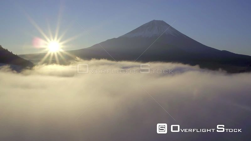 Aerial shot at sunrise tracking over clouds above Lake Shoji, with Mount Fuji in the background, Fuji Hazone Izu National Par...