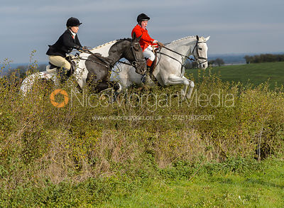 Tom Kingston, Georgie Mason jumping a hedge near Clawson Thorns
