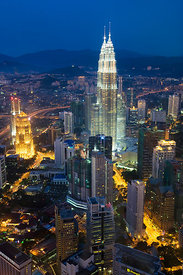 Petronas Towers at night - 88 storey steel clad twin towers with a height of 451.9 metres - the iconic symbol of KLCC (Kuala ...