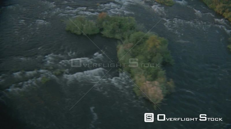 Aerial overhead shot fast flowing river with vegetation in middle of river Zimbabwe