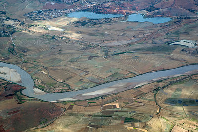 Aerial view of river surrounded by small agricultural fields, central Madagascar, September 2016.