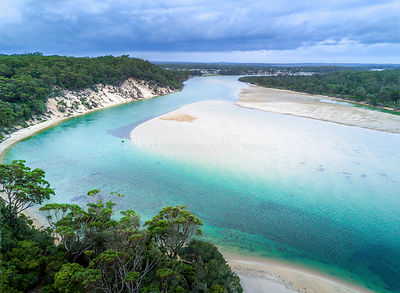 Unspoilt beaches with crystal clear water and purest of sands still an idyllic paradise even when storms loom overhead NSW Au...