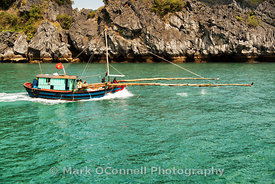 Fishing boat Halong Bay Vietnam 4
