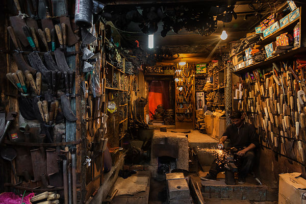 Knife Maker in his Shop