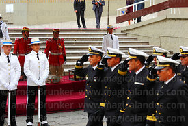 Members of the Bolivian navy salute as they parade past the remains of Eduardo Abaroa, Plaza Avaroa, La Paz, Bolivia