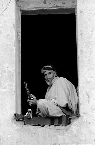 Mujahed Fighter in the ruins of a building
