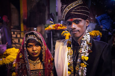 Portrait of a newly married couple at Dashashwamedh Ghat, Varanasi, India.