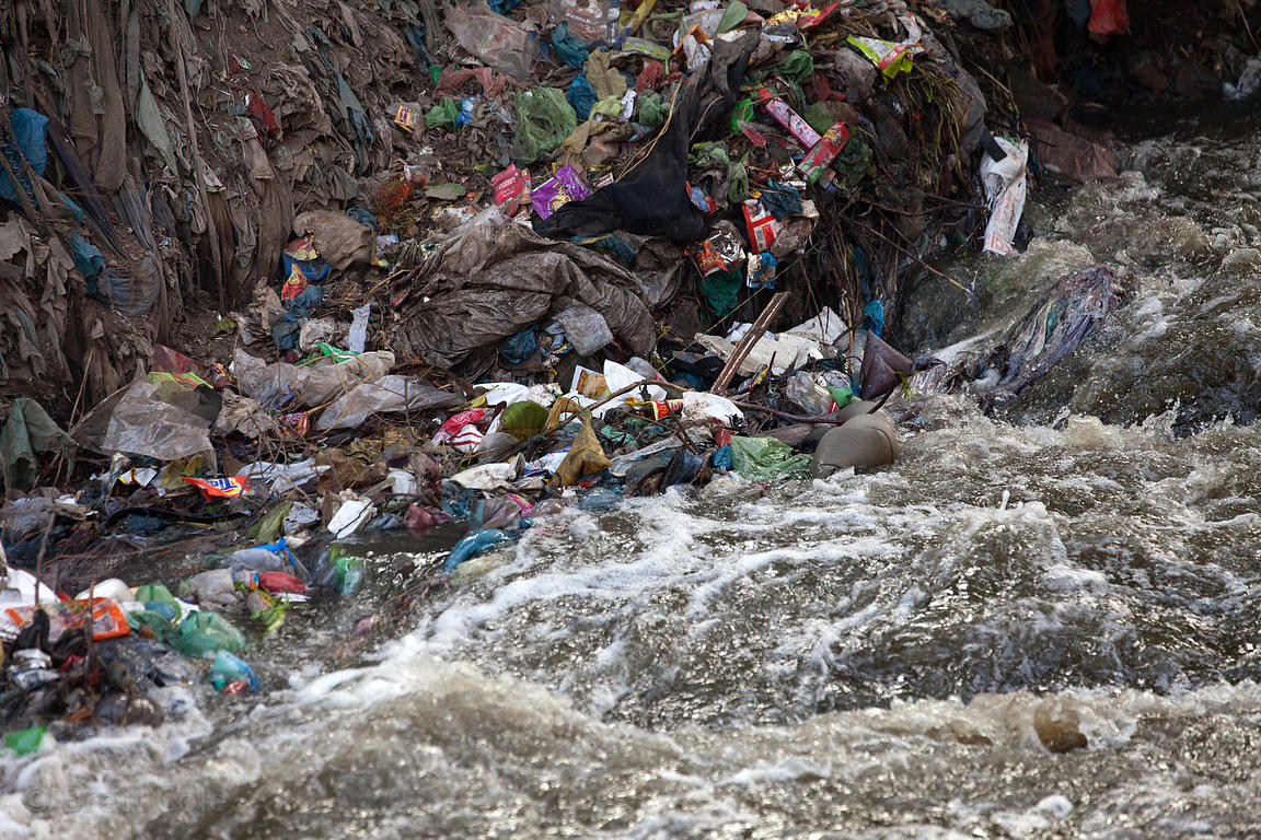 Garbage chokes a small stream flowing into the Ganges River near Nagwa Ghat, Varanasi, India.