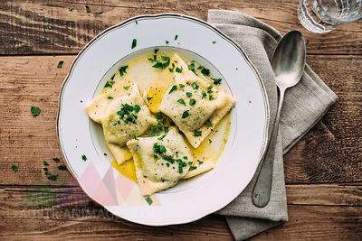 Vegetable ravioli in broth