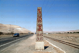 Obelisk next to Ruta 11 highway marking position of geoglyphs, Lluta Valley, Region XV, Chile
