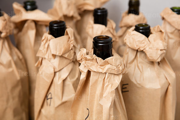 Close-up of brown bag wrapped wine bottle in a blind tasting