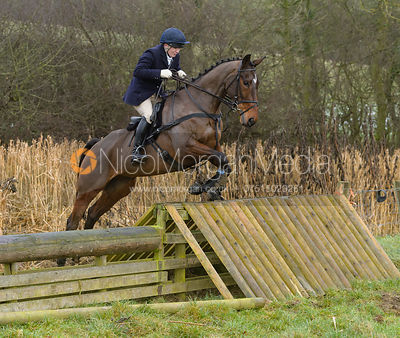 Harriet Walker jumping a hunt jump at Peakes - The Fitzwilliam Hunt visit the Cottesmore at Burrough House