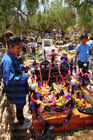 Grave gecorated with ribbons, food and pasankalla in cemetery for Todos Santos festival, Sipe Sipe, Cochabamba Department, Bo...