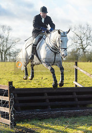Stephen Rayns jumping a fence at Cream Gorse - The Quorn at Cream Gorse Farm