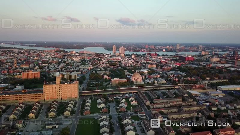 Wide tracking shot of train passed Ukranian church Drone Video Downtown Cityscape Philadelphia Pennsylvania USA