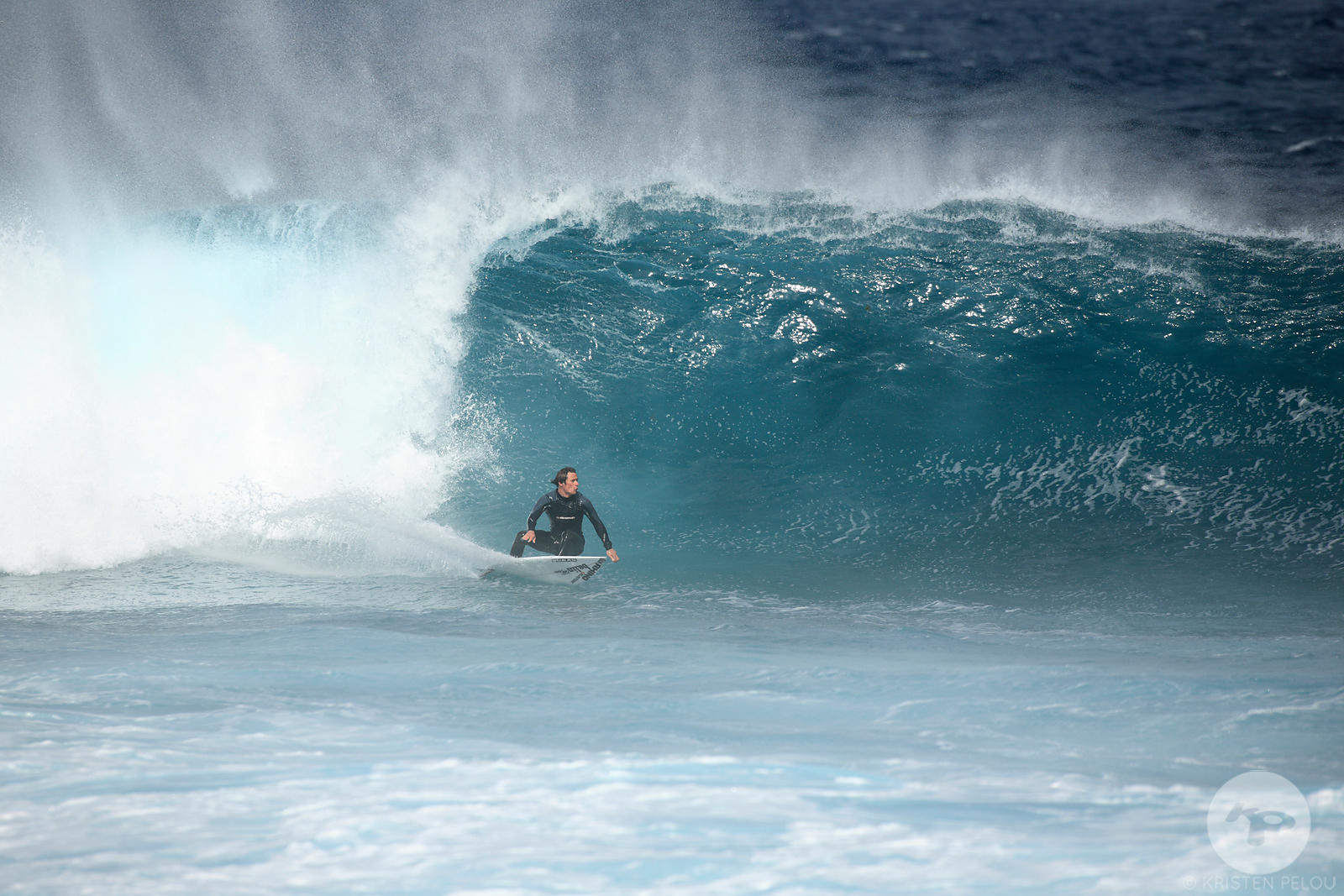 Dan Billon doing a backside bottom turn on a windy  wave, La Graciosa island, Canary islands, Spain, march 2008.