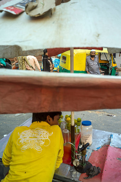 A Rickshaw Wallah And A Cold Drinks Seller