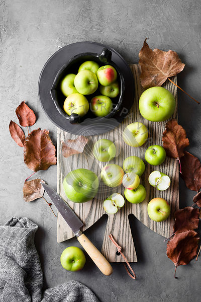 Green apples  on a chopping board