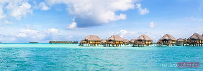 Panoramic of stilt huts in the lagoon of Bora Bora, Polynesia