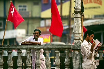 India - Kerala - A man watches a Communist rally
