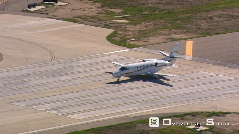 Control tower view of executive jet taking off