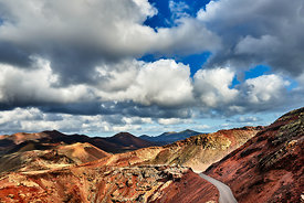A view across the valcanos in Timanfaya national park, Lanzarote, under a cloudy sky