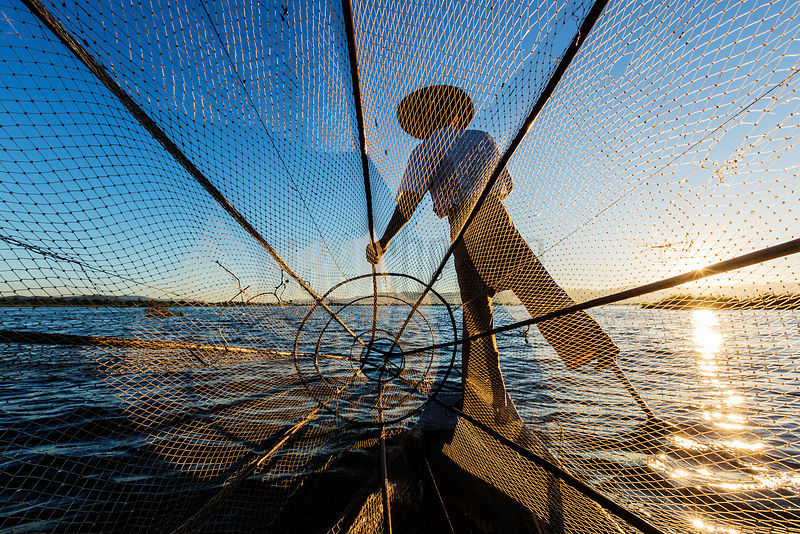 Fisherman Paddling his Canoe on Inle Lake