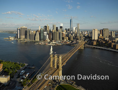 Aerial of Brooklyn Bridge spanning the East River.
