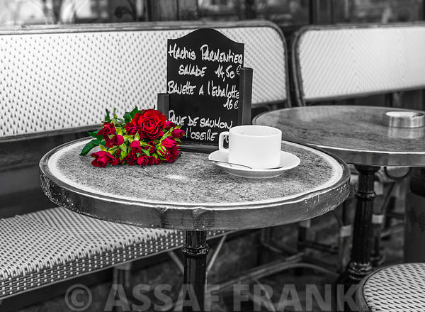 Bunch of flowers on sidewalk cafe table, Paris, France