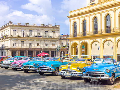 Traditional cuban cars parked in row by the road in Havava, Cuba