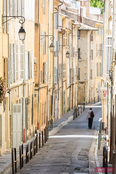 Man walking down typical alley in the old town, Aix en Provence, France