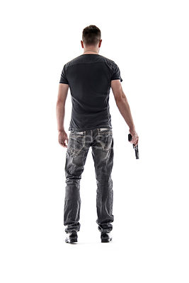 A mystery man, from behind, with a gun – shot from low level.