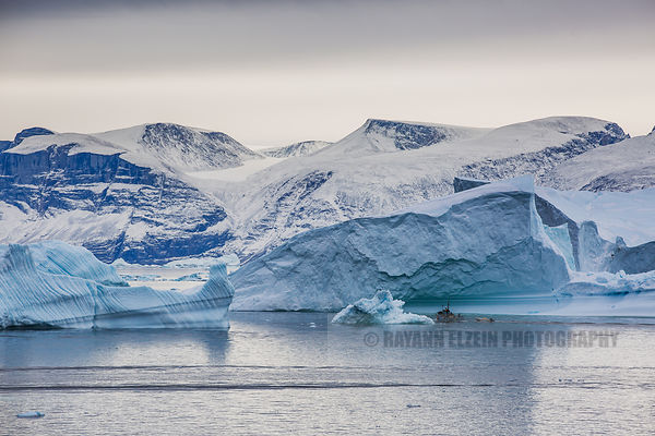 Fishermen navigating through the icebergs of the Uummannaq fjord