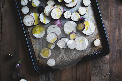 Baking tray with chopped Japanese eggplant.