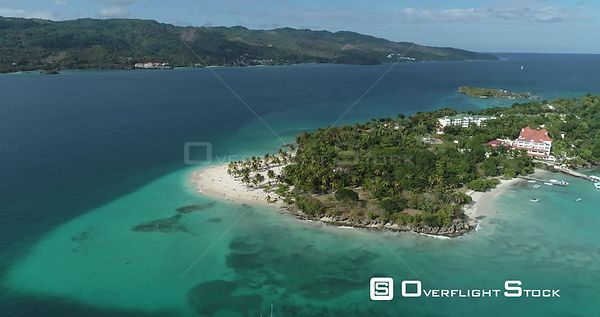 Small Caribbean island with palm trees. High altitude flight traveling arround to the left. Callo Levantado, Samana, Dominica...