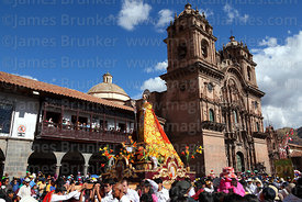 Figure of San Antonio Abad parades past Compañia de Jesus church during Corpus Christi festival , Plaza de Armas , Cusco , Peru