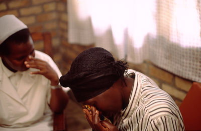 Rwanda - Kibileze - Sister Beatha Mukakaba comforts a woman after her HIV results