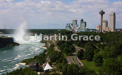 Canadian Horseshoe Falls and tourist high-rise buildings with the Skylon Tower prominent in the foreground, Niagara Falls, On...