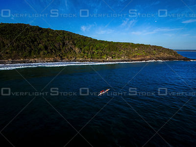 Outrigger Canoe in the middle of the bay, Noosa QLD Australia