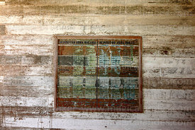 Board for recording amounts of water supplies in abandoned nitrate mining town of Humberstone, Region I, Chile