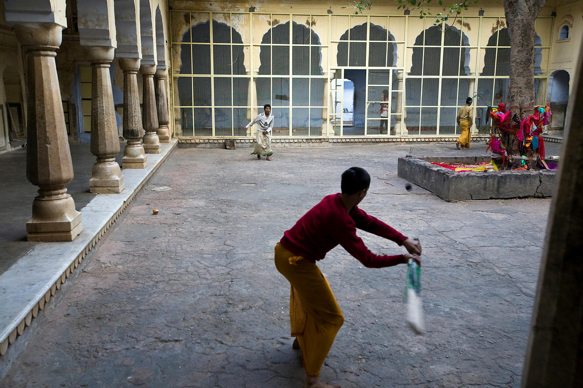 India - Jaipur - Boys play cricket inside one of the buildings of The Surya Mandir (known as the Monkey Temple)