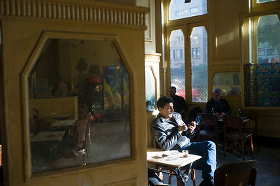 Egypt - Cairo - A man smokes in Al Hurriya a cafe bar once popular with Leftist activists