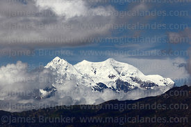 Clouds drift around Mt Illimani, Cordillera Real, Bolivia